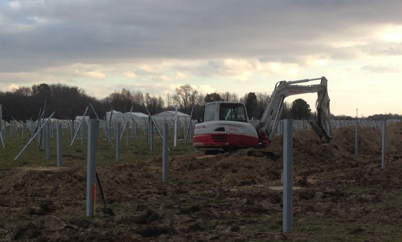 Carroll Bros. Contracting Digging the trenches in between the rows for the solar panels.